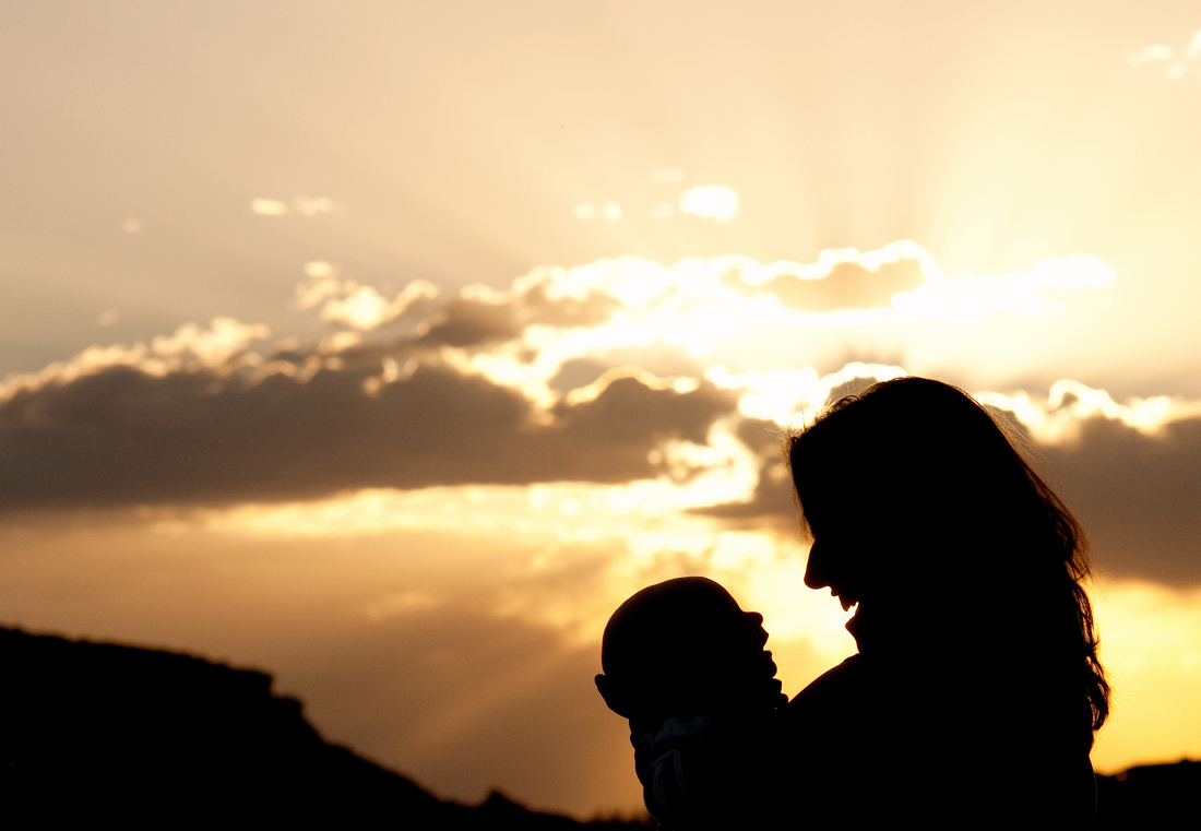 mother baby sunset silhouette
